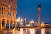 Overlooking the St. Mark's Square with the illuminated facade of the Doge's Palace and San Giorgio Maggiore church in the blue of the night, San Marco, Venice, Veneto, Italy