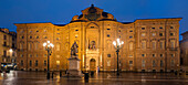 Panorama of the illuminated Palazzo Carignano in the blue of the night, UNESCO World Heritage Site residences of the House of Savoy, Turin, Piedmont, Italy