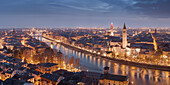 Wide view from Castel San Pietro over the nightly city of Verona with the towers of the church Santa Anastasia (right) and the Torre dei Lamberti (left) on the Adige, Veneto, Italy