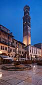 Piazza delle Erbe square in the historic center of Verona with the fountain of the Madonna Verona and the Torre dei Lamberti, Veneto, Italy