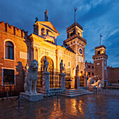 Arsenale di Venezia, the former shipyard and naval base in the blue of the night, with an illuminated wall and portal Ingresso di Terra left and Ingresso All'Acqua at the right, Venetian Arsenal, Castello, Venice, Veneto, Italy