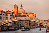 Overlooking the Grand Canal with gondolas in the evening sun and the Scalzi Bridge and in front of the Church of San Geremia, Cannaregio, Venice, Veneto, Italy