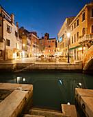 Illuminated Houses in Campo Santa Maria Nova and canal Rio del Miracoli in blue twilight, Cannaregio, Venice, Veneto, Italy