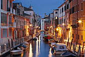 Illuminated Houses at Rio de la Fornace with boats in the blue of the night, Dorsoduro, Venice, Veneto, Italy