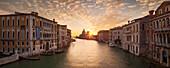Panoramic view of the Ponte dell'Accademia over the Grand Canal at sunrise, the Palazzo Cavalli-Franchetti left, the Palazzo Contarini Polignac right and the church of Santa Maria della Salute in the background, Dorsoduro, Venice, Veneto, Italy
