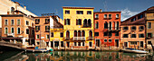 Panorama with colorful houses along the canal Rio di Santa Fosca and boats in the morning sun and blue sky, Cannaregio, Venice, Veneto, Italy