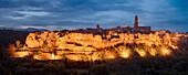 Panoramic views of the illuminated city Pitigliano at dusk, Province of Grosseto, Tuscany, Italy