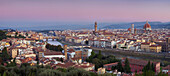 View from Piazzale Michelangelo shows the Arno Valley and Florence with the cathedral Santa Maria del Fiore and the Palazzo Vecchio at dawn, Tuscany, Italy