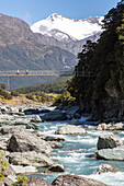 walking swing bridge Matukituki Valley, river, alpine scenery, snowy mountains, Mount Aspiring National Park, Southern Alps, South Island, New Zealand