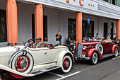 Art Deco Festival, vintage cars parked in front of Masonic Hotel, Napier, Hawke's Bay, North Island, New Zealand