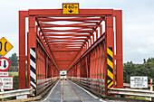 Taramakau railway road bridge, red, one way bridge, South Island, New Zealand