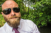 Man with beard and sunglasses in a kajak, Spreewald, Vacation, Family Tour, Family Celebration, Summer, Vacation, Oberspreewald, Brandenburg, Germany