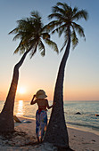 Woman on beach at sunset, Maafushi Island, Kaafu Atoll, Maldives, Indian Ocean, Asia