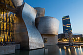 The Guggenheim Museum and Iberdrola Tower in Bilbao, Biscay (Vizcaya), Basque Country (Euskadi), Spain, Europe