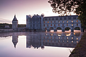 The chateau of Chenonceau reflecting in the waters of the River Cher at dawn, Indre-et-Loire, Loire Valley, UNESCO World Heritage Site, Centre, France, Europe