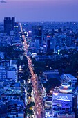 Vietnam, Ho Chi Minh City, elevated skyline view above Cach Mang Thang Tam Avenue, dusk.