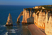 Etretat, Aval cliff , Falaise d'Aval, Natural Arch and Stone Beach, Normandy, Sunset, Seine Maritime, Upper Normandy, Haute Normandie, France.