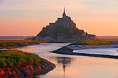 Mont St Michel, Sunset, Mont-Saint-Michel, Benedictine abbey, Pontorson, UNESCO, World Heritage Site, Manche, Normandy, France.