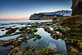 Sunset on the village perched on the promontory overlooking the beach of Carvoeiro Algarve Lagoa Faro District Portugal Europe.