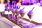 Chocolate mousse served in martini glasses at a party.