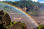 A river boat at the base of the falls, Iguazú Falls National Park, Misiones, Argentina, South America.