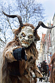 Krampuslauf or Perchtenlauf during advent in Munich, an old tradition taking place during christmas time in the alps of Bavaria, Austria and South Tyrol. The Munich Krampuslauf is a huge event and attraction, where Krampus groups from all over the alps ar