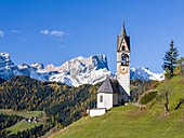 Chapel Barbarakapelle - Chiesa di santa Barbara in the village of Wengen - La Valle, in the Gader Valley - Alta Badia in the Dolomites of South Tyrol - Alto Adige, Geisler - Odle mountain range in the background. The Dolomites are listed as UNESCO World h