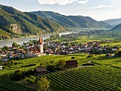 Medieval town of Weissenkirchen in the Wachau, with fortified church Mariae Himmelfahrt. The Wachau is a famous vineyard and listed as Wachau Cultural Landscape as UNESCO World Heritage. Europe, Central Europe, Austria, Lower Austria.