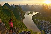 Sunset over hundreds of mountains, Xingping, Guangxi Autonomous Region, China.