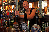 Barkeeper at beer pump, Covent Garden, London, Great Britain