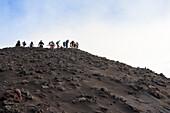 tourists climbing Stromboli Volcano, Stromboli Island, Aeolian Islands, Lipari Islands, Tyrrhenian Sea, Mediterranean Sea, Italy, Europe