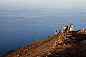Tourists on the summit of Stromboli Volcano at sunset, Stromboli Island, Aeolian Islands, Lipari Islands, Tyrrhenian Sea, Mediterranean Sea, Italy, Europe