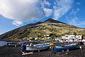 Black beach with fishing boats and Stromboli volcano, Stromboli Island, Aeolian Islands, Lipari Islands, Tyrrhenian Sea, Mediterranean Sea, Italy, Europe