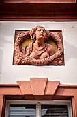 topless sand stone sculpture of woman at facade of Old Castle, Bayreuth, Frankonia, Bavaria, Germany