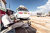 The gas station attendant counting his money, Damaraland, Kunene, Namibia