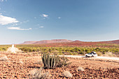 All-terrain vehicle on a dirt road in Damaraland, Kunene, Namibia