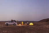 Two men camping in the plains of the Damaraland, Kunene, Namibia