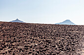 Two mountain tops in the vast rocky desert of Damaraland, Kunene, Namibia.