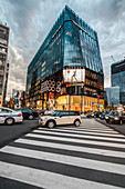 Crossing with pedestrians at Tokyu Plaza Ginza on a cloudy day, Ginza, Chuo-ku, Tokyo, Japan