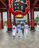 Four Japanese women wearing kimono and walking in front of Senso-ji Temple in Asakusa, Taito-ku, Tokyo, Japan
