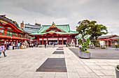 Kanda-Myojin Shrine with visitors and cloudy sky in Kanda, Chiyoda-ku, Tokyo, Japan