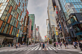 Zebra crossing with pedestrians during weekend in Ginza, Chuo-ku, Tokyo, Japan