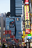 Cinema with Godzilla on the roof in Shinjuku, Tokyo, Japan