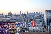 Shinjuku Skyline with big manga billboard seen from Shibuya, Tokyo, Japan