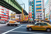 Chuo-Dori with taxi and Sobu Railway line in Akihabara, Chiyoda-ku, Tokyo, Japan