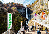 Tourists taking photo of Nikko Kegon Falls from viewpoint in Nikko, Tochigi Prefecture, Japan