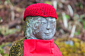 Jizo figure decorated with red knitted cap in Nikko, Tochigi Prefecture, Japan