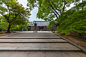 Stone stairs and bronze lantern at temple Ninna-ji, Kyoto, Japan