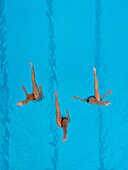 Aerial view of synchronized swimmers.