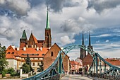 The Cathedral Bridge (most Tumski, also most Katedralny) connects the Sand Island (Wyspa Piasek) with the Cathedral Island (Ostrow Tumski). On the Cathedral Island are the Cross Church (left) and the Wroclaw Cathedral (right), Wroclaw, Lower Silesia Voivo
